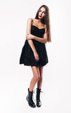 Cute teenager with red lips in black dress royalty free stock photo