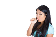 A cute teenager showing boredom by sucking her thumb Royalty Free Stock Images