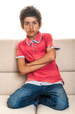 Cute teenager sitting on sofa Royalty Free Stock Photo