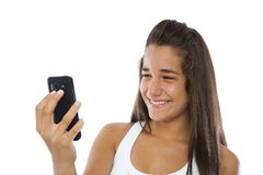 Cute teenager smiling with a mobile phone Royalty Free Stock Images