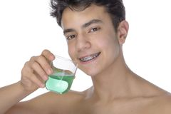 Teen boy wearing braces on white background Royalty Free Stock Image
