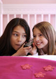 Cute teens on phone royalty free stock image