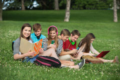 Cute Teens Studying Stock Image