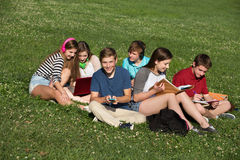 Cute Teens Studying Together Stock Photos