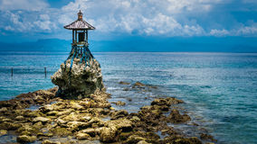 Cute Temple on the Shore by the Sea on Nusa Penida with Dramatic Clouds above Bali, Indonesia Royalty Free Stock Photo