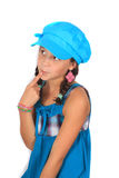 Cute ten year old girl contemplating. Pretty ten year old adolescent girl with braids and colorful blue dress and hat, thinking or contemplating Royalty Free Stock Photos