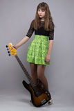 Cute tenage girl in dress with guitar Royalty Free Stock Photo