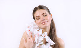 Cute tender woman with orchid on white background Royalty Free Stock Photos