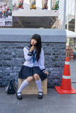 Cute Thai cosplayer dresses as Japanese schoolgirl posing Stock Photography