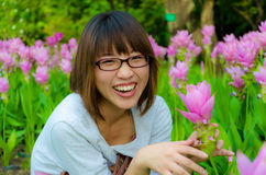 Cute Thai girl is laughing with flowers Stock Photo