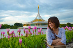 Cute Thai girl is relaxing beside the river bank Stock Images