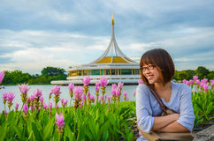 Cute Thai girl is relaxing beside the river bank Royalty Free Stock Images