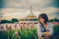 Cute Thai girl is relaxing beside the riverbank in vintage style Royalty Free Stock Photos