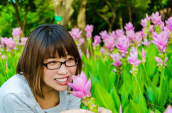 Cute Thai girl scent a pink Siam Tulip Stock Images
