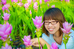 Cute Thai girl is very happy with flowers Royalty Free Stock Photo