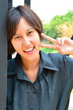 Cute thai lady. With victory sign Royalty Free Stock Photography