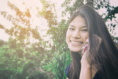 Cute Thai women calling some one on the phone Royalty Free Stock Photography
