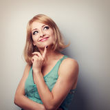 Cute thinking happy woman looking up with natural emotion and ca Stock Image