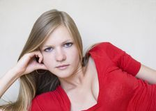Cute thoughtful girl in red blouse Stock Images