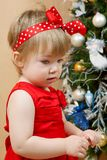 Cute thoughtful girl in red dress. Portrait of cute little girl in red princess dress Stock Photo