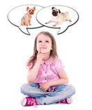 Cute thoughtful little girl sitting and dreaming about dog isola Stock Images