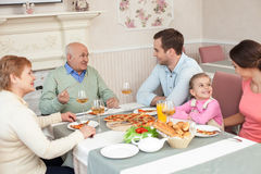 Cute three generations are gathering together in restaurant Royalty Free Stock Photos