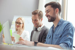 Cute three office workers are cooperating with joy Stock Images