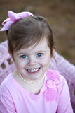 Cute three year old brunette girl outdoors Royalty Free Stock Photography