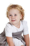 Cute three year old girl. Small blond three year old girl sitting on white background Royalty Free Stock Photos