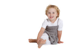 Cute three year old laughing. Cute three year old girl sitting on the floor on white background Stock Photography