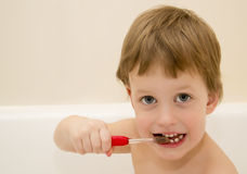 Three years child is brushing teeth Royalty Free Stock Photos