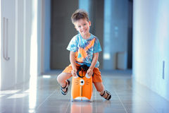 Cute three years old boy sitting on a suitcase Stock Photography