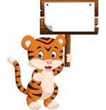 Cute tiger cartoon. Hanging wooden signboard Royalty Free Stock Photos