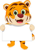 Cute tiger cartoon holding blank sign Royalty Free Stock Photography