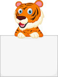 Cute tiger cartoon holding sign Stock Photography
