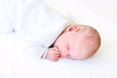 Cute tiny baby sleeping on a knitted blanket Stock Photos