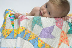 Cute Toddler. Image of cute toddler looking over the side of a tub lined with a quilt Stock Image