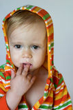 Cute Toddler. Image of cute toddler wearing a hooded jacket Stock Image