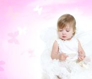 Cute toddler angel girl Stock Images