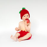 Cute toddler with apple Stock Image