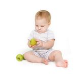 Cute toddler with apples Stock Photography