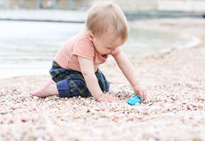 Cute toddler baby boy playing Royalty Free Stock Photos