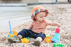 Cute toddler baby playing Stock Photo