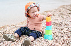 Cute toddler baby playing Royalty Free Stock Photography