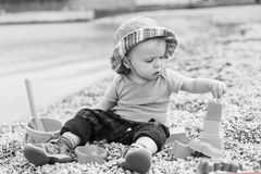 Cute toddler baby playing on the beach Stock Images