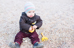 Cute toddler baby playing Stock Images