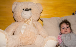 Cute toddler baby playing with a teddy bear Stock Photography