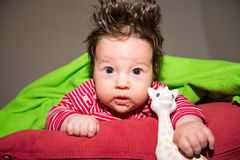 Cute toddler baby resting on the bed Stock Photos