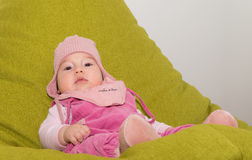Cute toddler baby resting in a green chair Stock Photography