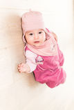 Cute toddler baby resting on the ground Stock Images